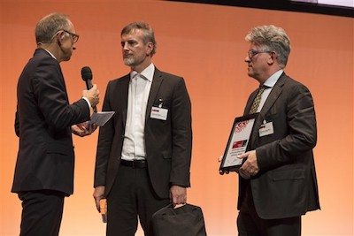 Gambardella and Schmidhuber accept the award